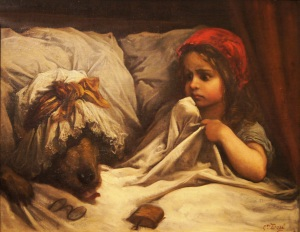 The wolf adopts the identity of Red Riding Hood's grandmother by dressing in her bedclothes.
