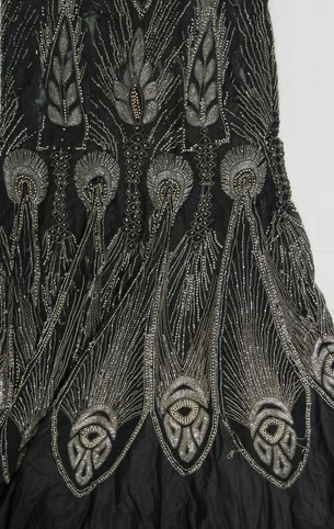 Detail of vintage beading. When the dress is laid out for display like this, it is possible to examine and appreciate the craftsmanship. The beauty of the surface decoration makes 1920s dresses appealing collectors items, even for those who never intend to wear them.