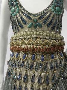 1920s party dresses by Paul Poiret and others. With their delicate beading, these are too fragile to be worn as vintage clothing, and instead have value as collectors items.