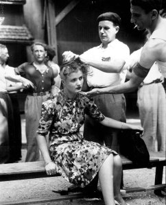 A French woman has her head shaved in punishment for collaborating with Germans, 1944. Image courtesy: Remembering History