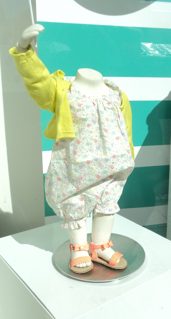 Mannequins at GAP Kids are headless yet animated - simultaneously lively and lifeless.