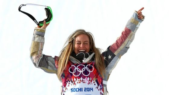 Jamie Anderson, winner of the gold medal for slopestyle snowboarding, wears stars and stripes on her sleves, but the blue and red of the American flag are subdued.