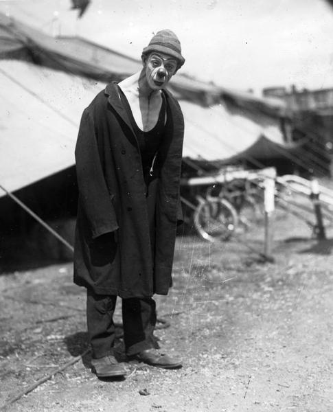 "Circus clown, ""Bumpsy"" Anthony, dressed in clothes that appear to have been appropriated in an act of bricolage, rather than tailored to fit his body."
