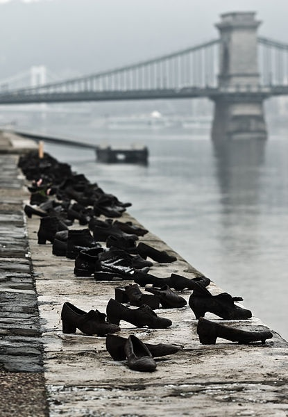 'Shoes on the Danube Promenade' by Can Togay and Gyula Pauer. During WWII, Jews in Budapest were brought to the edge of the Danube, ordered to remove their shoes, and shot, falling into the water below. 60 pairs of iron shoes now line the river's bank.