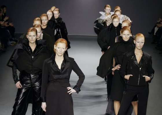 Viktor & Rolf designed their Fall 2003 collection in collaboration with Tilda Swinton, who models it here alongside an army of models made up to look like her doppelgangers.