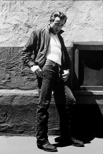 James Dean, costumed for Rebel Without a Cause (1955). Here he adopts a pose that is dependent on the style of his clothes, using his pockets to rest his hands, and so to shape his body posture.